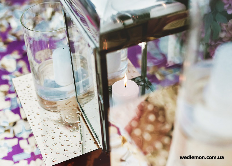 свічки на весілля у вазах циліндрах та ліхтарях
